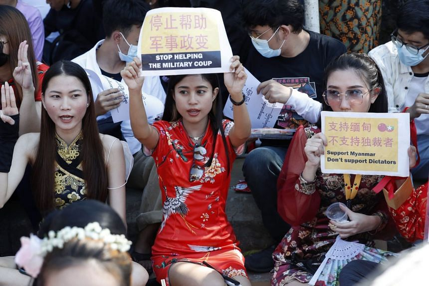 People protest against the military coup in front of the Chinese embassy in Yangon, Myanmar, Feb 11, 2021.