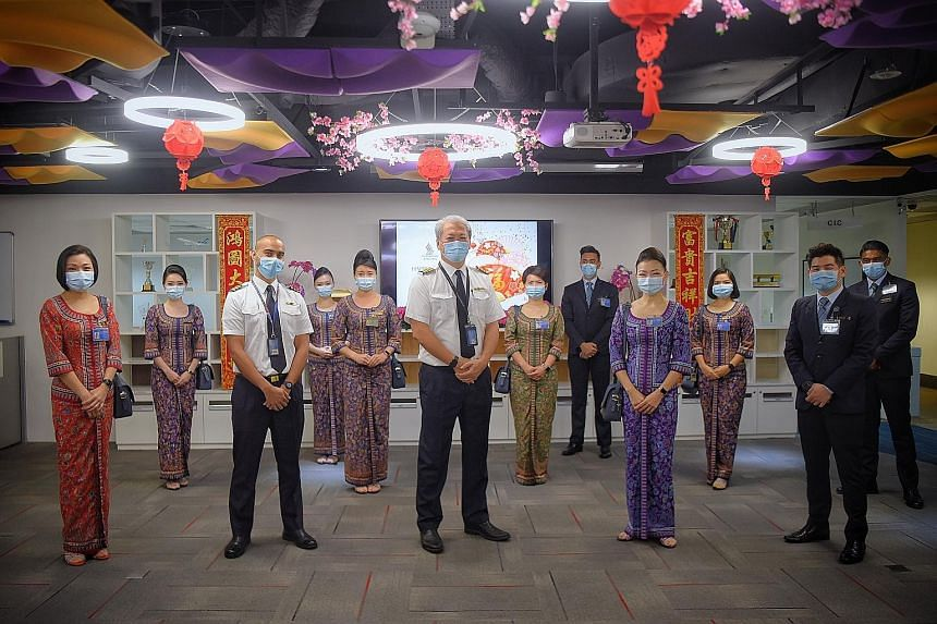 Flight SQ956 took off for Jakarta at 9.30am carrying a crew of 12 (left), and is the first of three departing SIA Group flights with crew who have received both doses of the Pfizer-BioNTech vaccine.