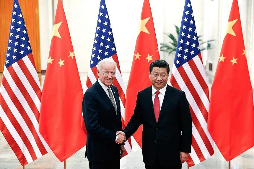 A CALL FOR BETTER CHINA-U.S. TIES President Xi Jinping and President Joe Biden when they met in 2013 in Beijing during Mr Biden's time as vice-president. In yesterday's phone call, the two leaders exchanged views on countering the pandemic and other