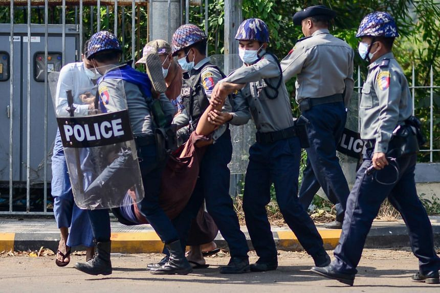 Police arrest a protester during a demonstration against the military coup in Mawlamyine, Myanmar, on Feb 12, 2021.