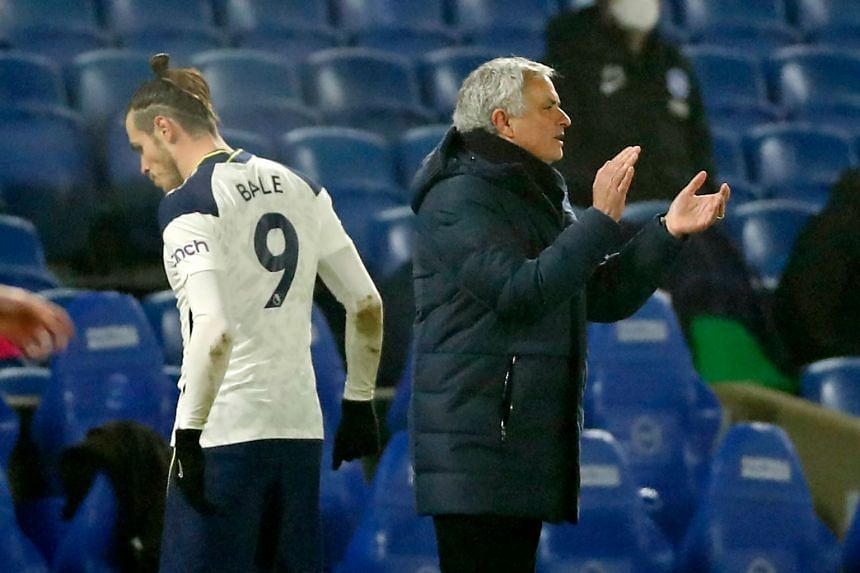 Bale is substtuted as Spurs play Brighton, with Mourinho looking on from the touchline.