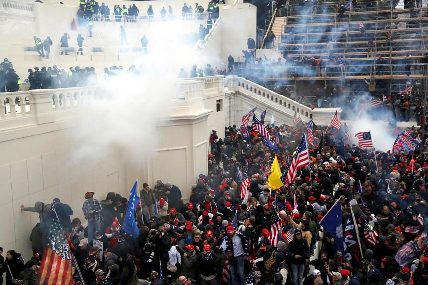 In a photo taken on Jan 6, 2021, police release tear gas into a crowd of pro-Trump protesters at the US Capitol Building.