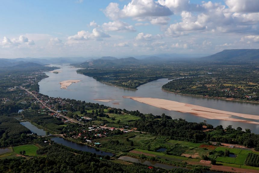 The vital waterway has turned blue along the Thai-Laos border, from its usual murky brown colour.