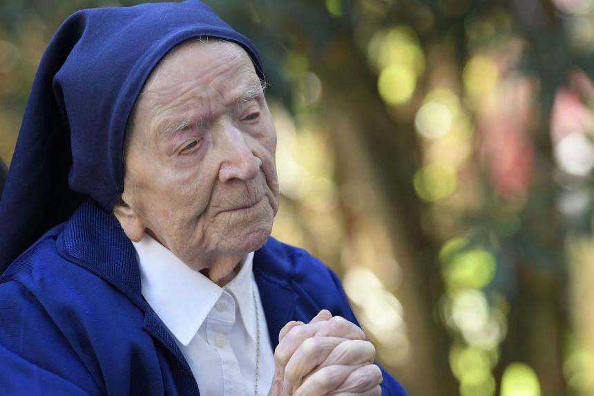 Sister Andre prays on the eve of her 117th birthday.
