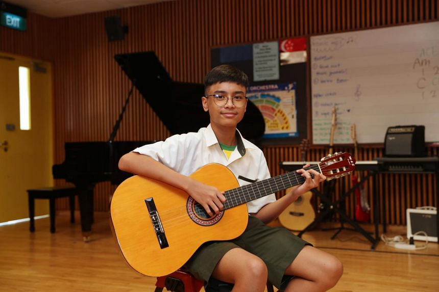 Secondary 1 student Arish Putra Muhammad Sufi secured a spot in Orchid Park Secondary with his talent in playing the guitar.