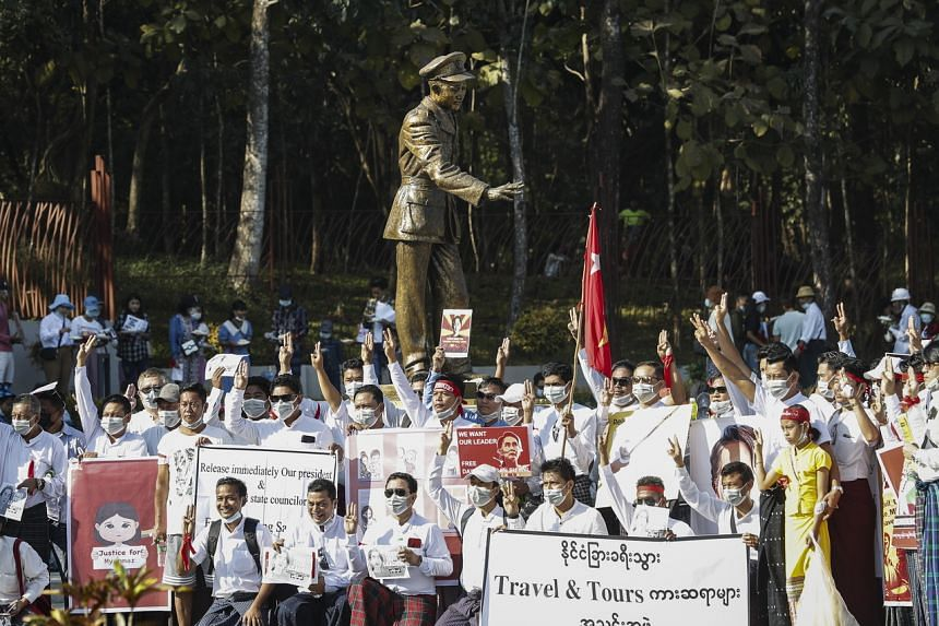 Protesters gather in front of the statue of Myanmar's independence hero General Aung San to mark the anniversary of his birth, in Yangon, Myanmar, on Feb 13, 2021.