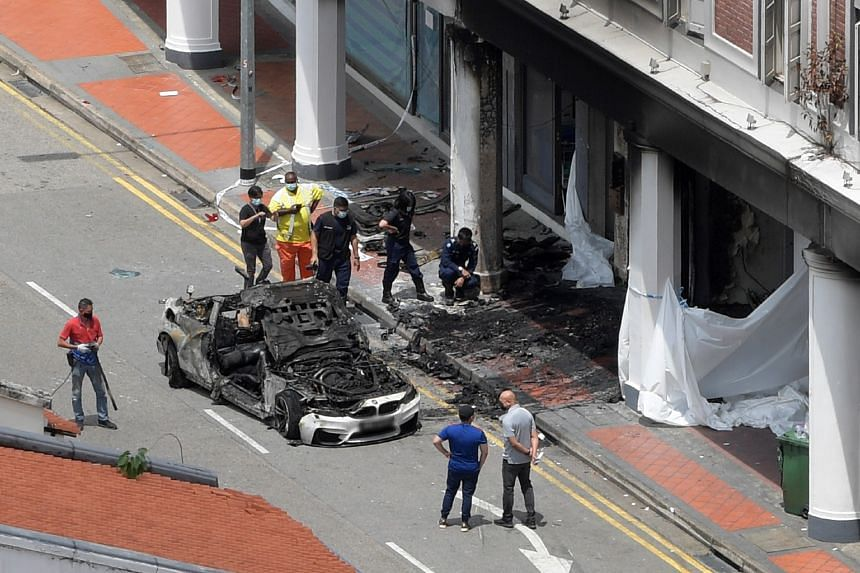 The car was believed to have sped along Tanjong Pagar Road before colliding into a shophouse and catching fire.