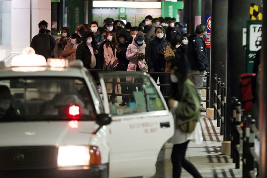 People line up for taxis after the earthquake, in Sendai, northeastern Japan.