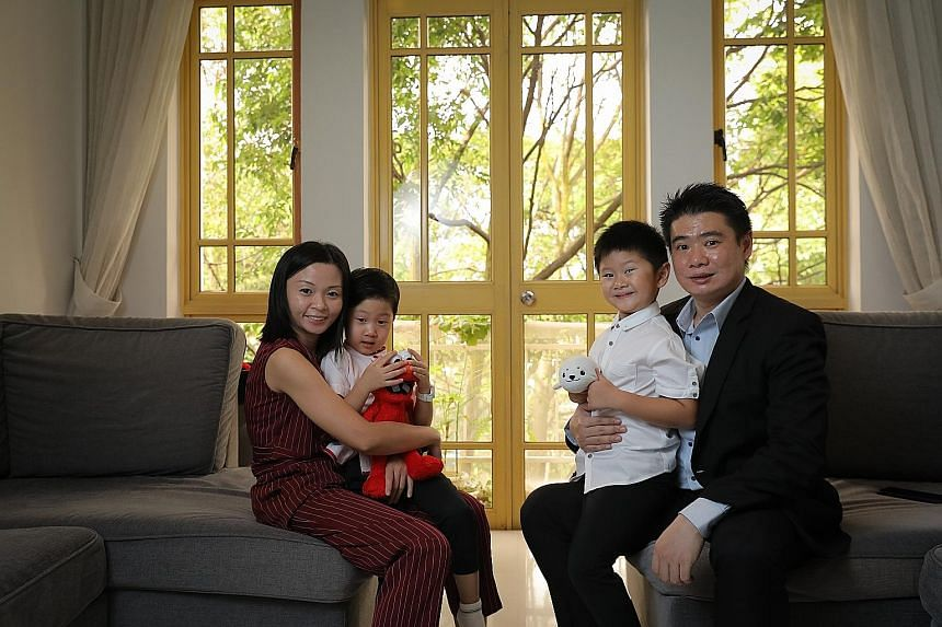 Mr Eugene Koh, 38, ERA Realty Network's executive group division director, with his wife Flavia Teo, 32, and his sons Aiden, four, and Ryden, six. The family lives in a 1,281 sq ft, three-bedroom apartment at the Villa Marina Condominium near East Co