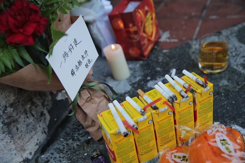 Offerings seen at the accident site on Feb 14, 2021.