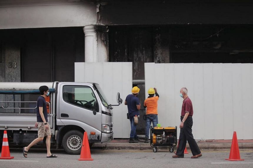 Workers sealing the accident site on Feb 14, 2021.