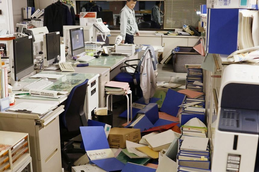 File folders and other items are seen scattered on the floor of a Hirono town office on Feb 13, 2021.