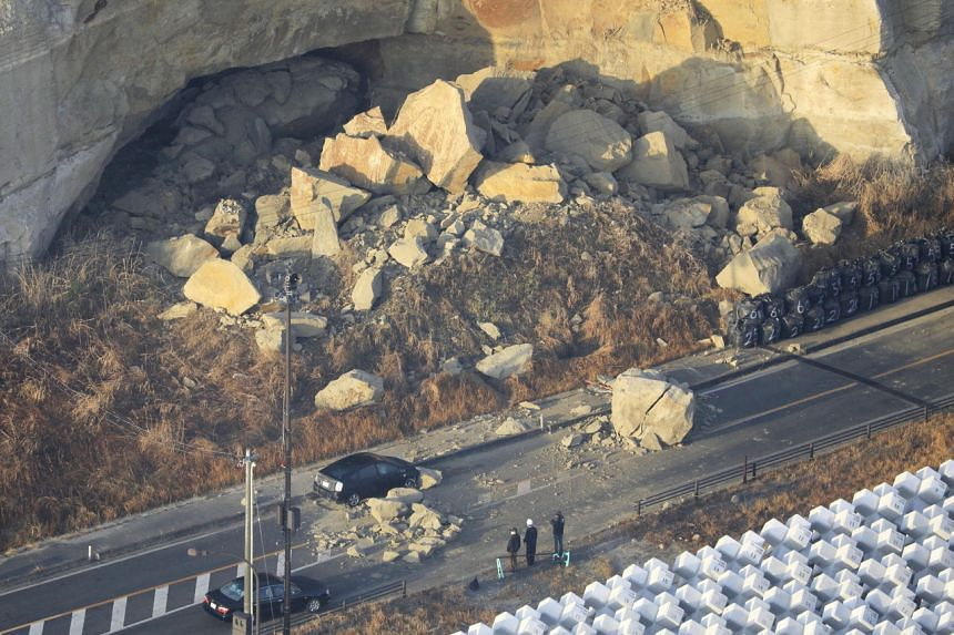 A landslide caused by a strong earthquake blocks Joban Expressway in Soma, Japan, on Feb 14, 2021.