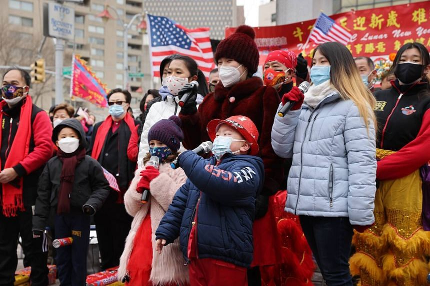 The US national anthem being sung at a Chinese New Year ceremony in New York City's Chinatown on Feb 12, 2021.
