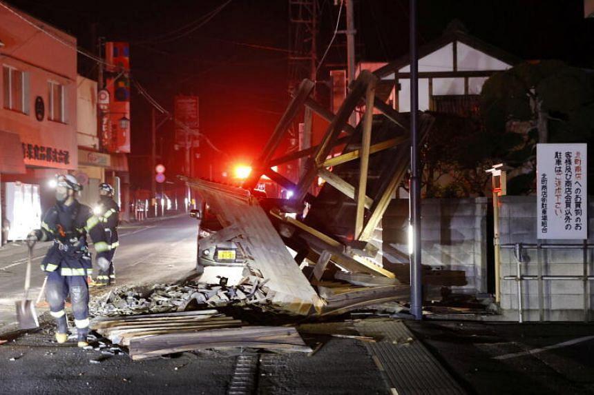 A broken gate is seen following a strong earthquake, in Koori, Fukushima prefecture, on Feb 14, 2021.