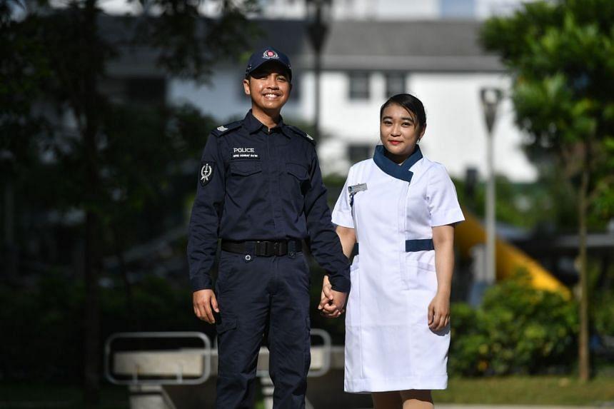 Mr Afiq Ashraf Ra'im, an Emergency Response Team operator at the Singapore Police Force, and his wife, Ms Khairunnisa Suwarno, a senior staff nurse at Khoo Teck Puat Hospital.