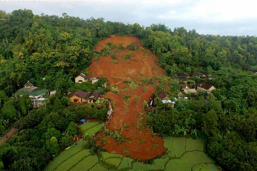 At least 13 houses have been damaged in the landslide in Nganjuk, Indonesia, on Feb 15, 2021.