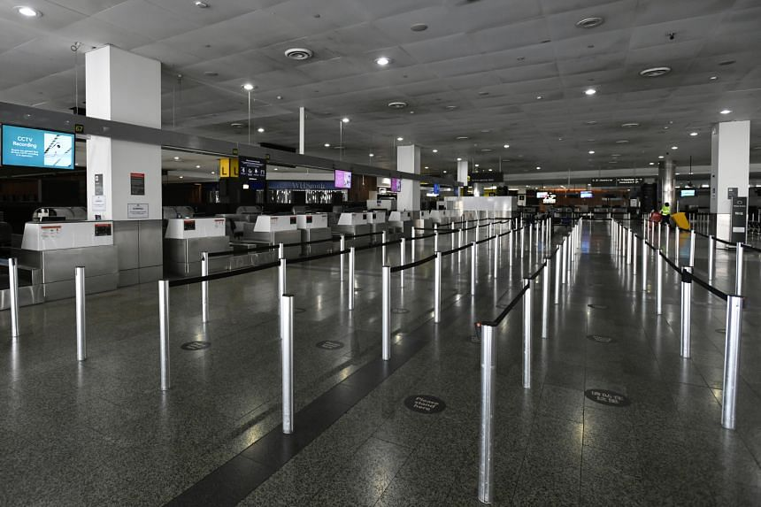 Empty international check-in terminals are seen at Melbourne Airport on Feb 13, 2021.