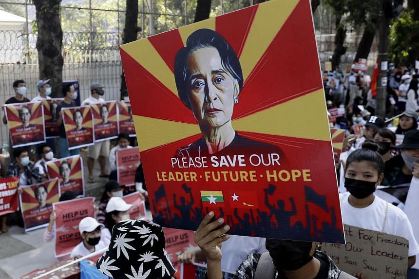 Demonstrators hold placards calling for the release of detained Myanmar's civilian leader Aung San Suu Kyi, in Yangon, on Feb 14, 2021.