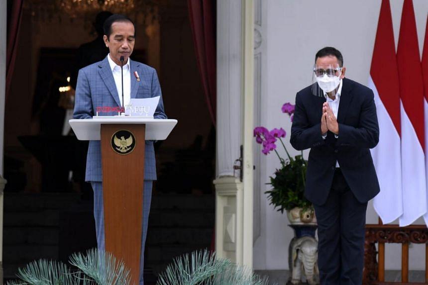 Indonesian president Joko Widodo (left) said Ridha Wirakusumah was formerly the CEO of PT Bank Permata.