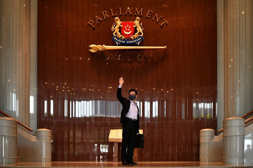 Deputy Prime Minister Heng Swee Keat arrives at Parliament House to deliver his Budget speech, on Feb 16, 2021.