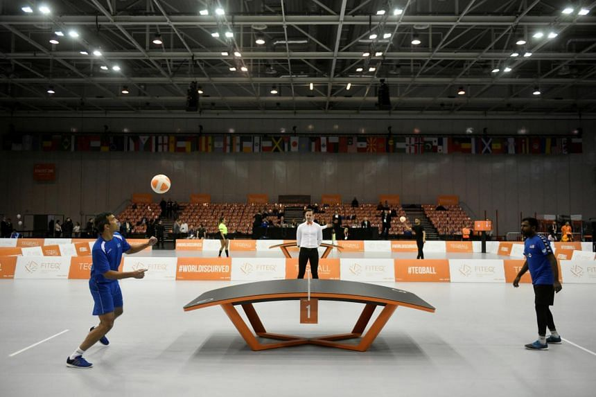 In a photo from Dec 6, 2019, Aruba's Gregory Engelbrecht and Malaysia's Al Barilan Shahul Hameed compete at the Teqball World Championships in Budapest.