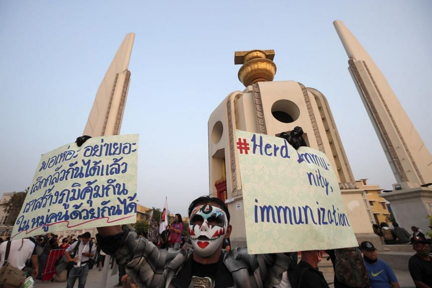 A Thai pro-democracy protester at the Democracy Monument in Bangkok, on Feb 13, 2021.