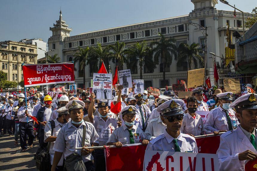 Railway workers protesting in Yangon on Feb 13, 2021.
