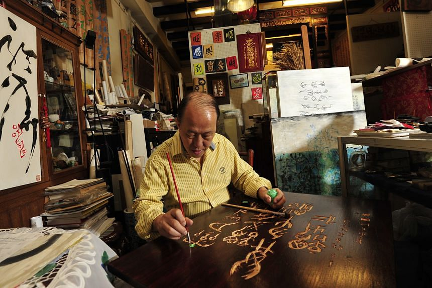 Making of Chinese signboards.