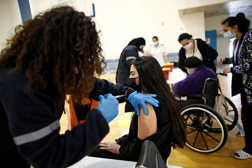 A woman is vaccinated against coronavirus at a centre in Tel Aviv, Israel, Feb 16, 2021.