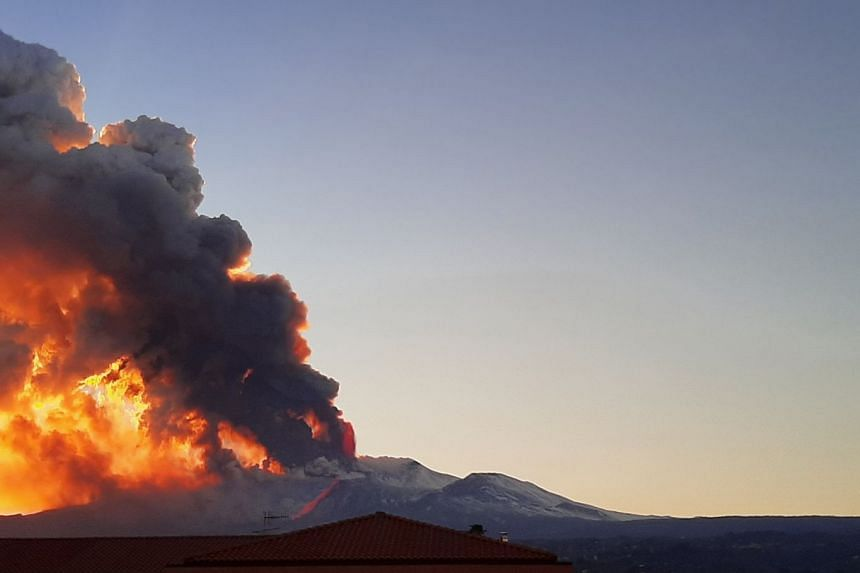 Ash spews from Mount Etna as seen from Riposto, Italy, on Feb 16, 2021 in an mage taken from social media.