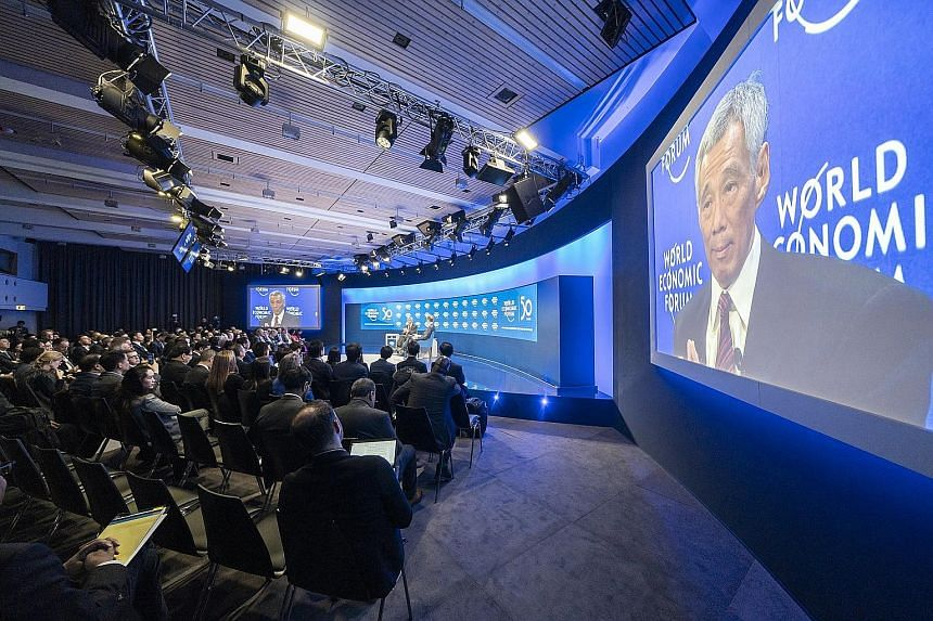 Prime Minister Lee Hsien Loong speaking on Jan 22 last year at the World Economic Forum's meeting in Davos, Switzerland. This year's forum, initially set to be held in Davos, was moved to Singapore because of the perceived Covid-19 risks of hosting t
