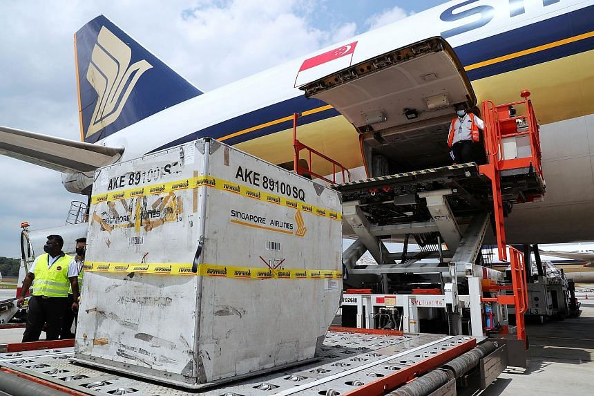 The first shipment of Moderna vaccines being unloaded at Changi Airport on Feb 17, 2021.