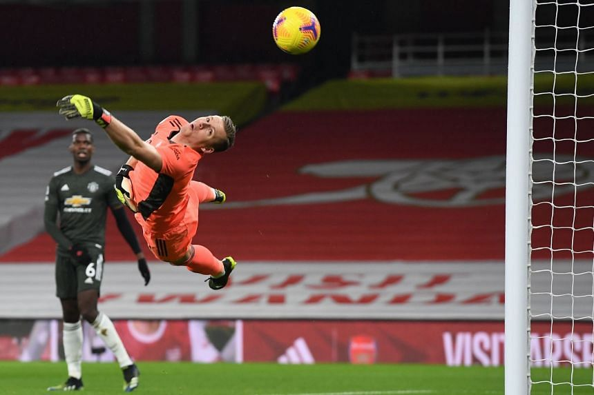 Leno dives as a shot from Manchester United's Bruno Fernandes (not pictured) goes wide on Jan 30, 2021