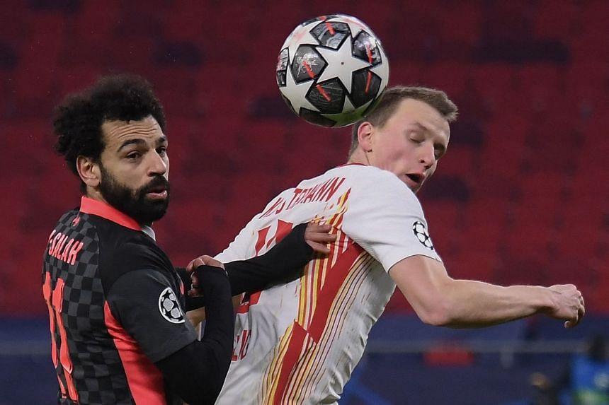 Liverpool's Mohamed Salah (left) and Leipzig's Lukas Klostermann vie for the ball.
