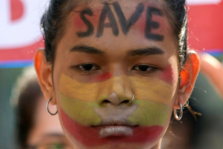 A demonstrator takes part in a protest against the military coup in Yangon, on Feb 17, 2021.