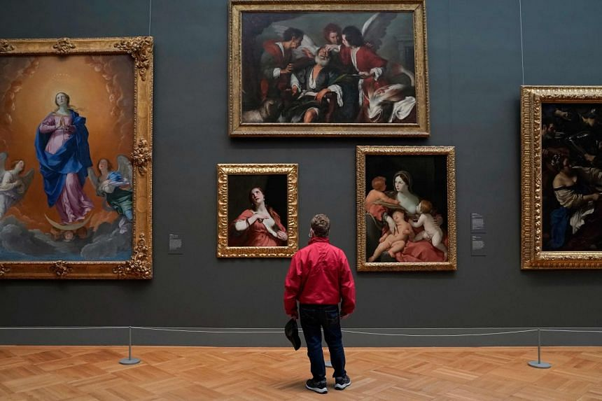 A patron looking at works in the exhibition, A New Look At Old Masters, at New York's Metropolitan Museum of Art in December. The exhibition may also be experienced virtually.
