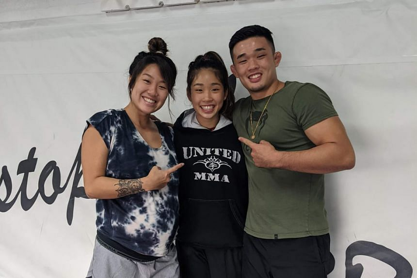 Victoria Lee, the 16-year-old who will make her professional MMA debut on Feb 26, flanked by her siblings and One Championship mixed martial arts (MMA) world champions, Angela, 24, and Christian, 22.