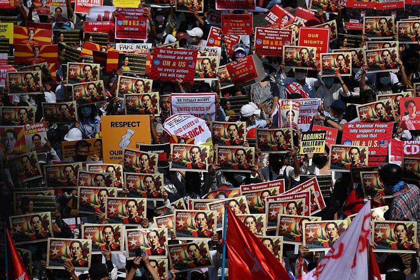 Protesters holding signs of deposed civilian leader Aung San Suu Kyi during a demonstration in Yangon yesterday. Social media has linked them to Hong Kong and Thai users who have swopped tips on staying safe during protests.