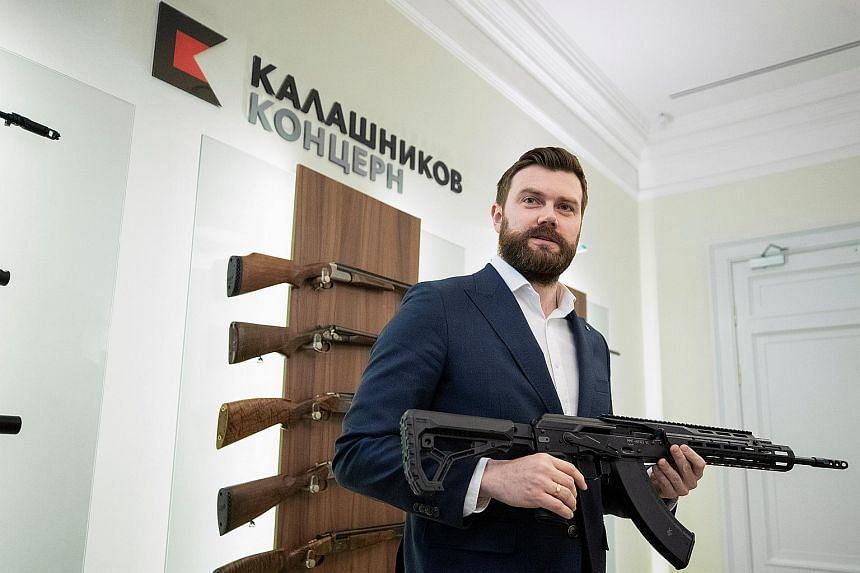 Kalashnikov CEO Dmitry Tarasov showing off one of his company's weapons during an interview in Moscow on Feb 8, 2021.