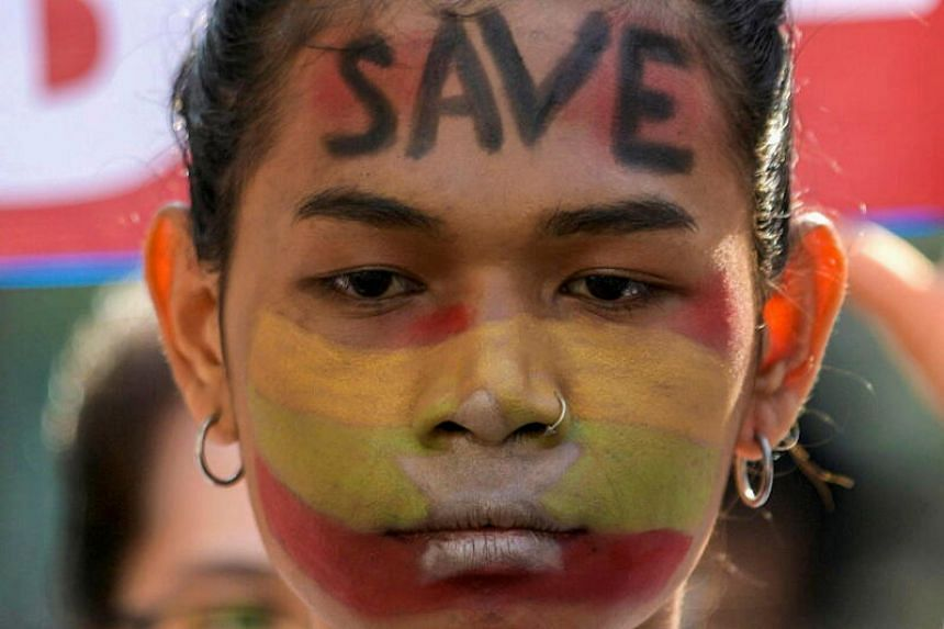 A demonstrator takes part in a protest against the military coup in Yangon, Myanmar, on Feb 17, 2021.