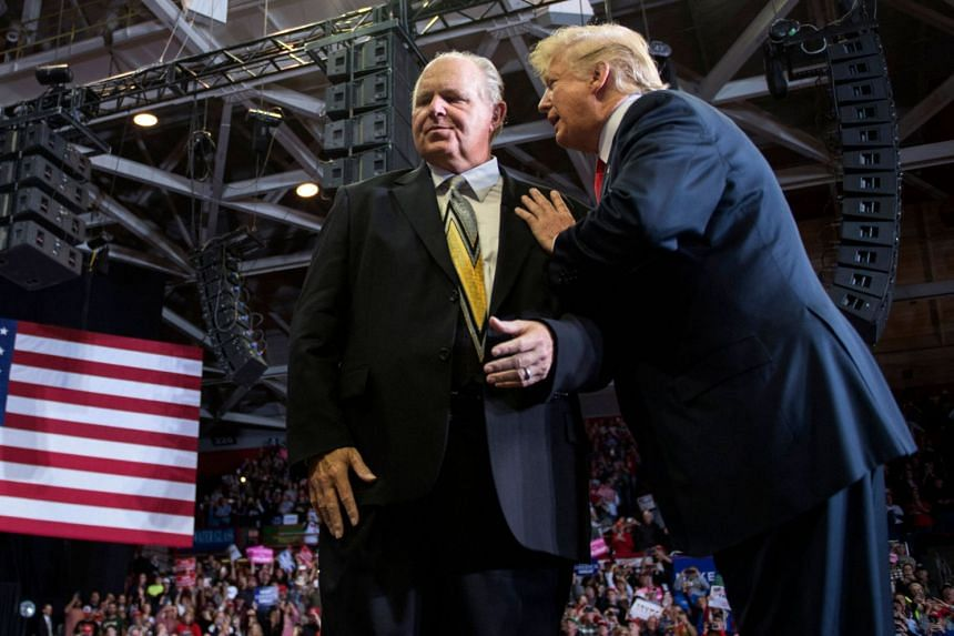 A 2018 photo shows Limbaugh (left) with US president Donald Trump at a rally in Missouri.