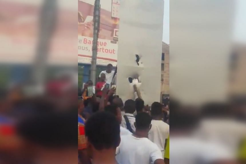 People hit the structure with a stick in a screenshot from a video posted online.