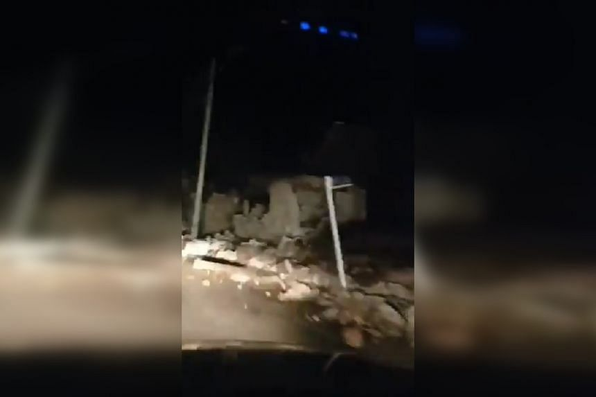 Damaged buildings are seen in a screenshot from a video uploaded to social media, said to show the town of Sisakht.