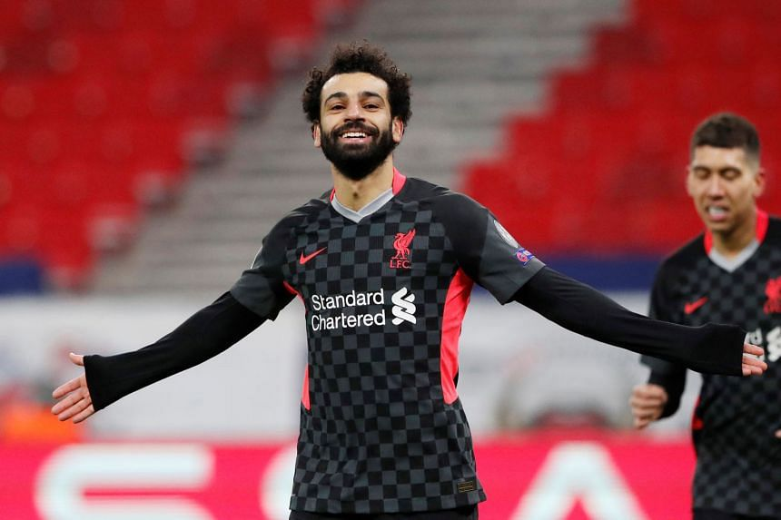 Forward Mohamed Salah celebrating after scoring the opener in Liverpool's 2-0 Champions League last-16, first-leg victory over Leipzig on Tuesday that ended a three-game losing streak.