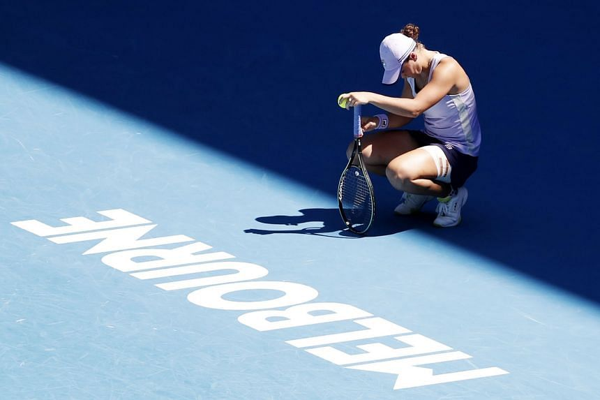 Australia's Ashleigh Barty is dejected after losing to Czech Karolina Muchova (above) yesterday in the Australian Open quarter-finals in Melbourne.