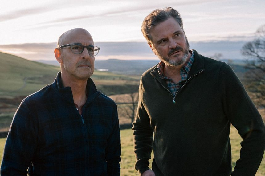 Tusker (Stanley Tucci, left ) and Sam (Colin Firth, right).