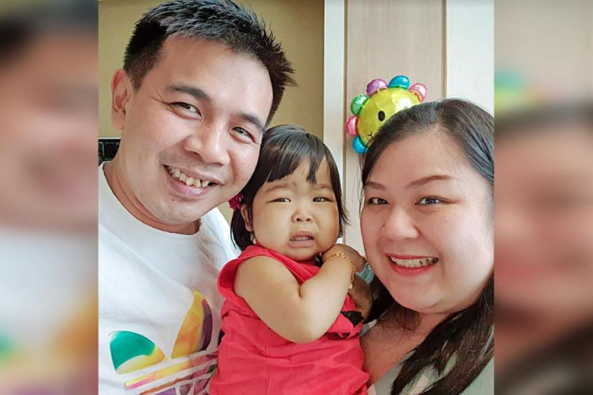 Ms Vicky Cheng and Mr Roger Wong with their daughter Raenelle, who was diagnosed with a rare liver disease soon after birth.