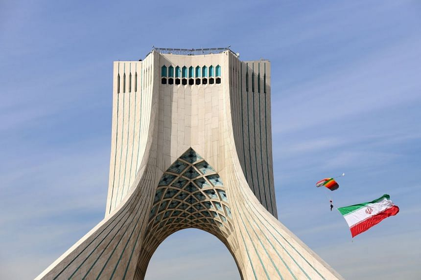 A parachutist is seen with the Iranian flag in Teheran, during celebrations for the 42nd anniversary of the Islamic Revolution.