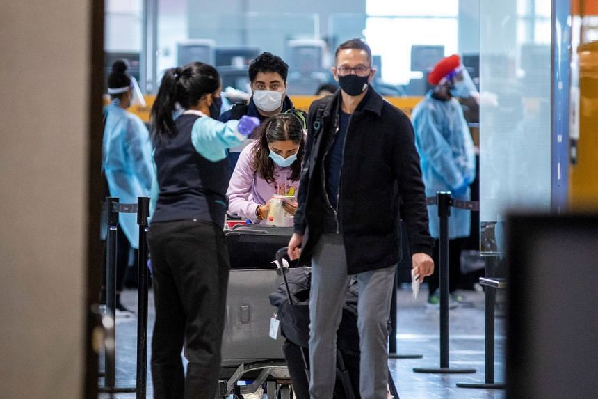 Passengers wait to be tested after they arrive at Toronto's Pearson airport in Canada on Feb 15, 2021.